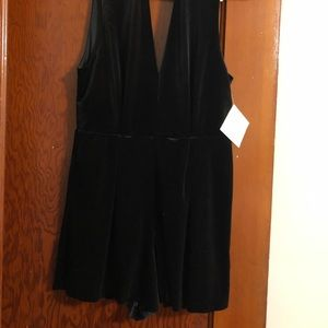 Black velvet romper with lace open back